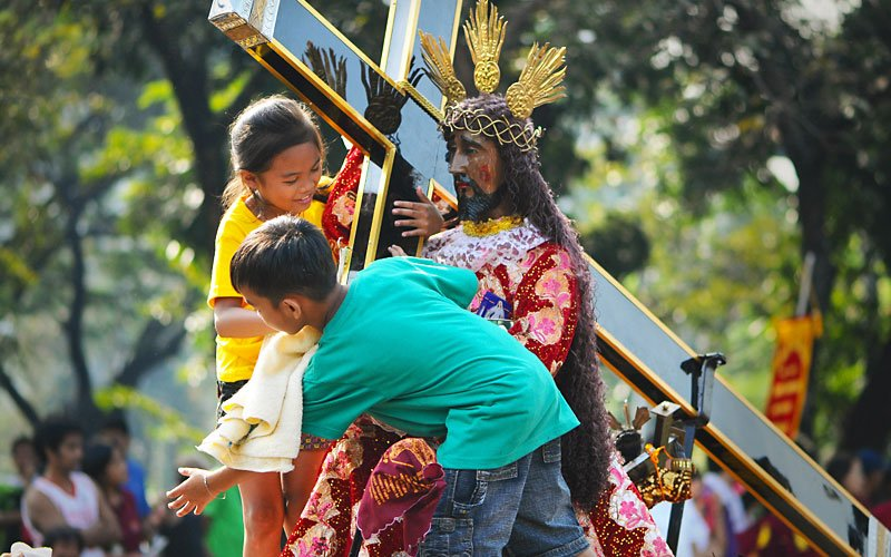 the feast of the black nazarene One of the faithful rubs a black jesus icon outside the saint john the baptist church during the annual procession of the feast of the black nazarene january 9, 2003 in the quiapo district of manila, philippines.